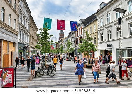 Aarhus, Denmark - July 20, 2017: People Stroll Along The Shopping Mile Ryesgade In The Centre Of The