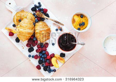 Fruity Breakfast. Breakfast With Freshly Baked Croissants, Fresh Summer Berries And Honey. Top View,