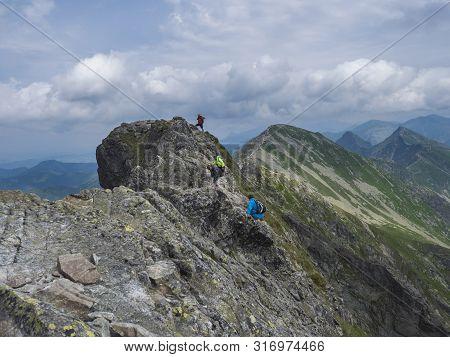 Slovakia, Western Tatra Mountain, Rohacska Dolina, July 2, 2019: Peope Climbing On The Hiking Path O