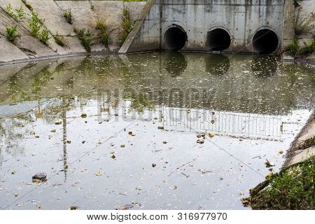 A Drain Pipe Or Sewage Or Sewage Discharges Waste Water Into A River. Wastewater Or Domestic Wastewa