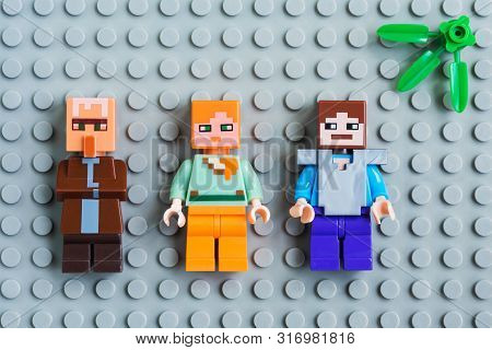 Kiev, Ukraine - May 26, 2019: Minifigure Steve, Alex And Villager Are Characters Of The Game Minecra