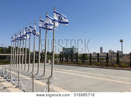 Jerusalem, Israel. August 13, 2019. A Row Of Flags Of Israel In Front Of The Israeli Parliament Knes