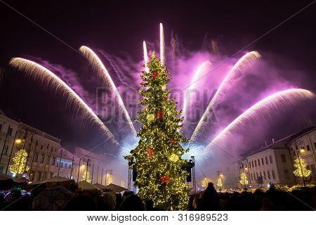 Banska Bystrica, Slovakia - January 1, 2019: New Year`s Eve Firework Behind Christmas Tree. Celebrat
