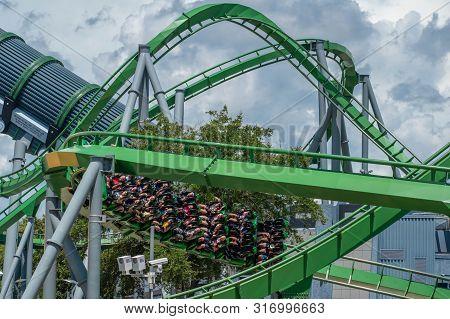 Orlando, Florida. August 07, 2019. People Having Fun Terrific The Incredible Hulk Rollercoaster , Du