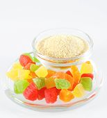 Gelatin and colorful jelly isolated on white. poster