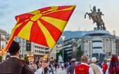 SKOPJE/NORTH MACEDONIA-AUGUST 28 2018: Bulgarian performers at Skopje International festival of music and dance parade across Stone Bridge towards Macedonia Square to dance and perform,before heading back over the Bridge towards Old Bazaar. poster