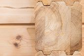 Wood Glued timber close up. Wooden grain timber end background. Glued pine timber beams. Wood for building a house. Building materials made of wood. Glued beams. Wooden beams in the groove. poster
