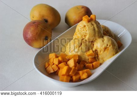 Scoops Of Home Made Mango Ice Cream Served With Fresh Cut Lalbagh Mangoes.