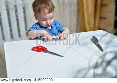 Danger In The Home, Tablets Are Dangerous For Young Children. Little Boy Takes Pills From The Table.