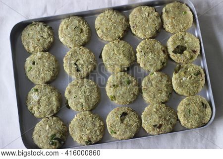 Chicken Cutlets Patties Coated With Bread Crumbs On Tray. Waiting To Get Set Before Deep Frying.