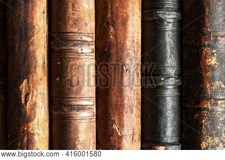 Stack Of Old Books On A Library Shelf. Vintage Books