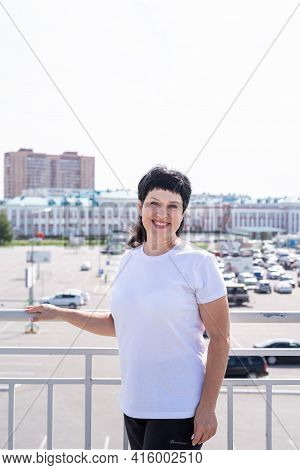Smiling Senior Woman Working Out Outdoors On Urban Background