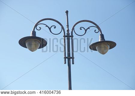 Vintage Street Light.black Street Lamp In An Open Blue Sky . Street Lantern On Background Blue Sky .