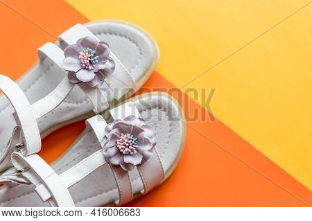 Leather White Baby Girl Summer Sandals With Flower Decoration.baby Girl Shoes On Colorful Background