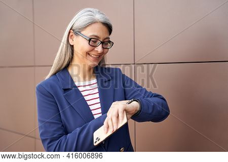 Punctual Businesswoman Keeping Track Of Time In Work Purposes