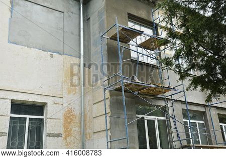 Building Repair And Facade Renovation By Plastering The Facade Walls And Applying Stucco. Plastering