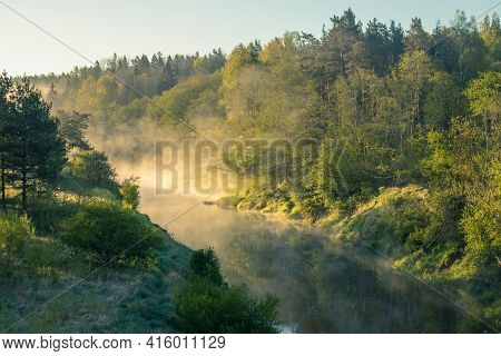 A Beautiful Spring Landscape Of A River Valley With Morning Mist. Springtime Scenery Of A River Flow