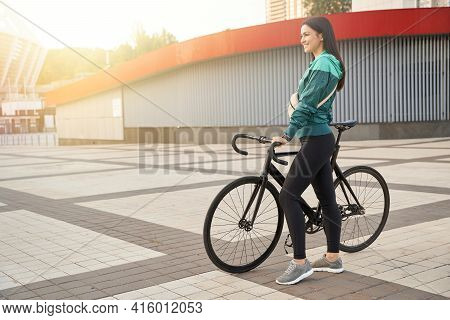 Smiling Beautiful Female Going For Bike Ride In The City