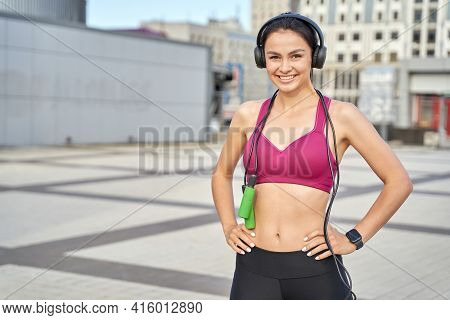 Happy Young Lady Posing With Jumping-rope In The City
