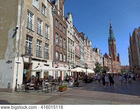 Gdansk, Poland - May 07, 2020: People Walk At The Dlugi Targ Street. Few Tourists Also Visiting The
