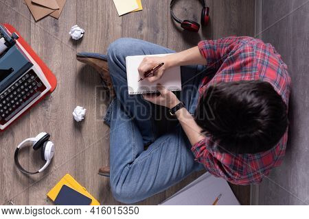 Man writing in notebook noting thinking idea solitions. Student man online larning. Creative inspiration study concept
