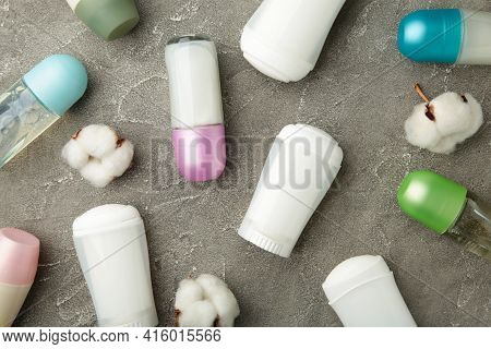 Different Deodorants With Cotton On Grey Background. Top View.