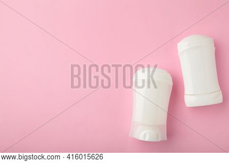 White Antiperspirant Deodorant On Pink Background. Skin Care Concept. Copy Space