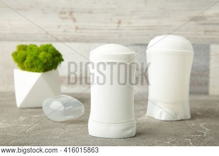 White Deodorants With Flower On Light Background. Top View.