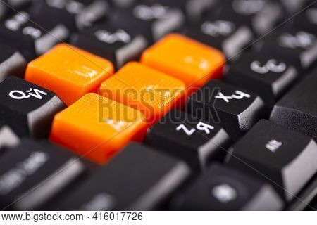 Close-up Of Orange Arrow Keys On A Black Keyboard, Up, Down, Left, Right Buttons On A Gaming Compute