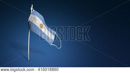 Argentina Mask On Dark Blue Background. Waving Flag Of Argentina Painted On Medical Mask On Pole. Co
