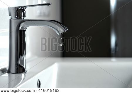 Clean Water Is Dripping From The Faucet In The Bathroom.