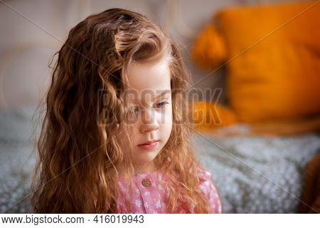 Portrait Of A Sad And Brooding Girl Close-up. Children's Emotions. Melanhonic Mood