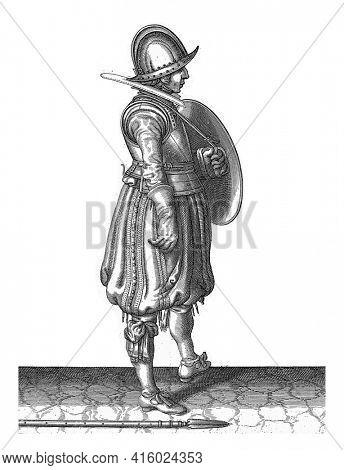 The exercise with shield and spear: the soldier with the shield ready and the spear next to his right foot on the ground, vintage engraving.