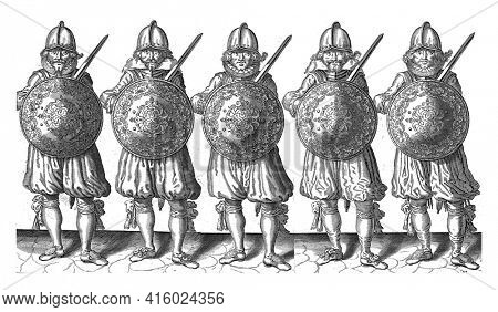 The exercise with shield and spear: five soldiers standing side by side in line with the rapier in the right hand and the shield over the chest, vintage engraving.