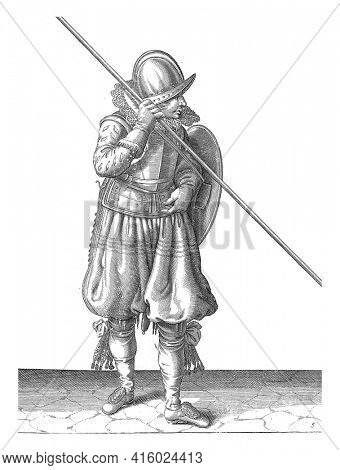 The exercise with shield and spear: the soldier holds the spear in the hand and inserts the shield when marching the back in front of the body, vintage engraving.