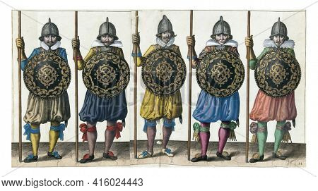 The exercise with shield and spear: five soldiers standing side by side in line with the spear resting in the right hand on the ground and the shield in front of the chest, vintage engraving.