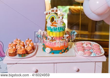 Big Cake On The Unicorn And Rainbow Theme. Sweets For Children With Fantasy Style. Multi Colored Can