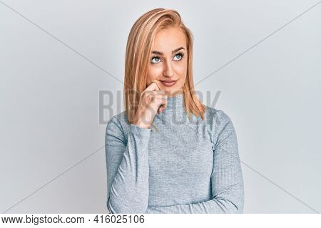Beautiful caucasian woman wearing casual clothes thinking concentrated about doubt with finger on chin and looking up wondering