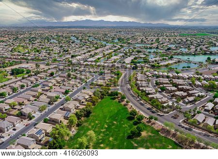 Aerial Roofs Of The Many Small Ponds Near A Avondale Town Houses In The Urban Landscape Of A Small S