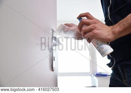 Man Hand Cleaning Desinfected Metallic Door Handle Door Knob With The Paper Tissue And Desinfection