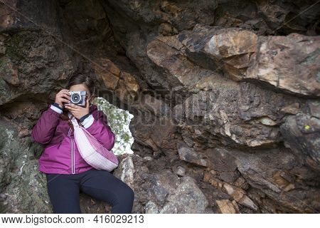Child Girl Taking Pictures From Rock Shelter. Children Discover Nature Through The Photography