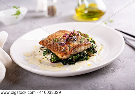 Sauteed Fish With Leafy Greens And Rice