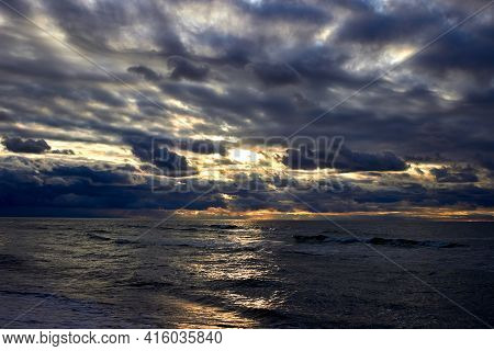 The Dramatic Sea And Sunbeams Make Their Way Through The Clouds. Sunset On The Baltic Sea