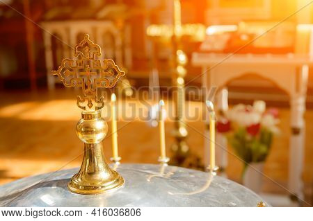 Cross In The Sun In The Church. Orthodox Cross In The Sun On The Lid Of The Bowl For The Rite Of Inf