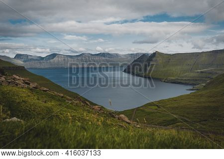 Spectacular Views Of The Scenic Fjords On The Faroe Islands Near The Village Funningur With Mountain