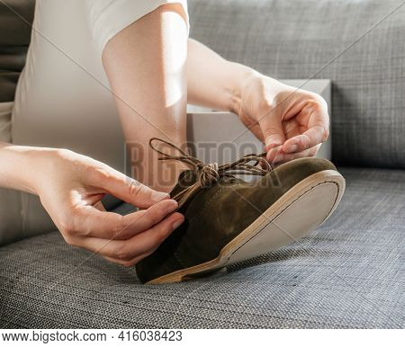 Close-up Detail Of Woman Hands Tying Laces On New Nubuck Luxury Leather Shoes With Genuine Italian L