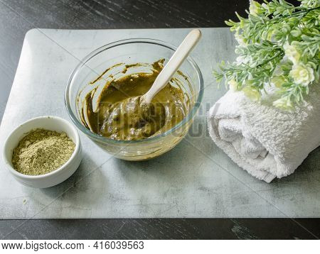 Henna Dry Powder, Glass Bowl With Henna Rehydrated, White Terry Towel On A Marble Mat. Home Hair Col