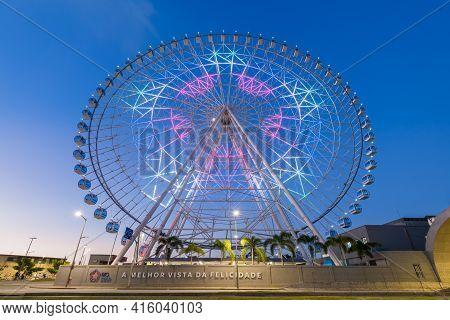 Rio De Janeiro, Brazil - March 21, 2021: Rio Star Ferris Wheel At Night Is Illuminated With Colorful