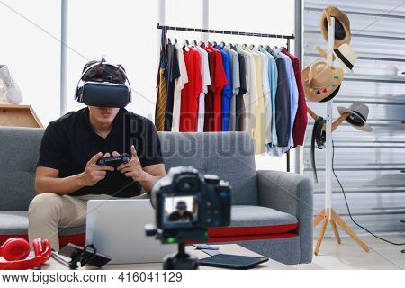 Gamers Are Cast Games Via The Streaming Applications. An Asian Man Online Blogger Uses A Camera To R
