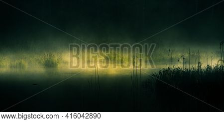 Dramatic, Artistic Scenery Of A Sunrise Over Flooded Wetlands In Northern Europe. Springtime Swamp W